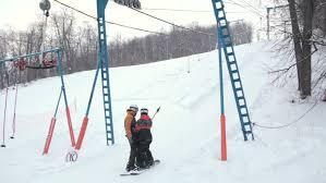Backyard Ski Lift Skiers Sliding Up To The Mountain With Ski Tow Stock Footage