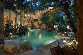 pool landscaping pool tropical with garden lighting tropical