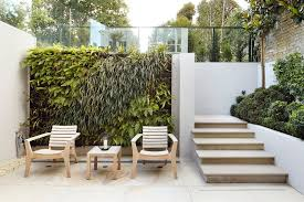 imaginative living wall planter with wooden chairs dyer grimes
