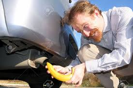 putting banana into car exhaust pipe stock photo picture and
