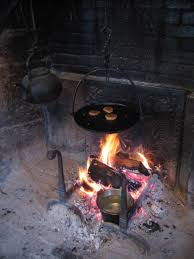 old dark kettle cooking fireplace crane flame rustic fireplace