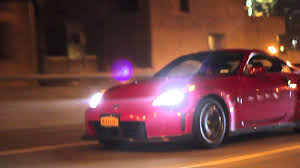nissan 350z nismo hp 350z red nismo cruising the streets of nyc under new york