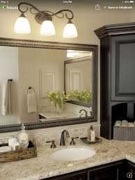 sw black fox painted cabinets 3 light fixture with mirror