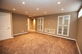 large basement space with minimalist themed using grey accents