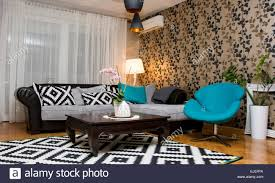 eccentric design for living room interior with blue black and