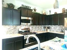 how to decorate top of kitchen cabinets top of cabinet decor ideas kitchen cabinets decorating ideas add