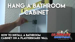 how to hang a cabinet to the wall how to install a bathroom cabinet on a plasterboard wall