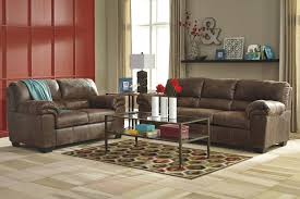 Faux Leather Living Room Set Casual Faux Leather Sofa By Signature Design By Ashley Wolf And