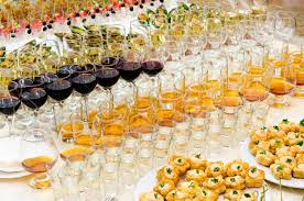 a lot of alcohol drinks on buffet table catering stock photo