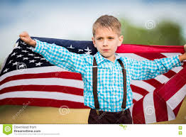 Country American Flag A Young Boy Holding The American Flag Showing Patriotism For His
