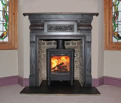contura wood stove and reion cast iron mantel