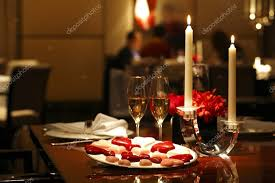 romantic table settings romantic table setting with chocolates candle and wine stock