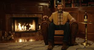 nick offerman does a yule log christmas video while drinking