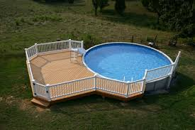 exterior rounded pool with brown painted wooden deck which