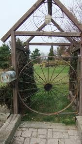 Metal Arbors Old Hay Rake Wheel Repurposed As A Garden Gate Garden Ideas