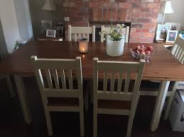 country style cream and wood six seater dining table and chairs