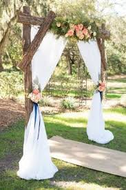 wedding arches on a budget scenic alaska inn wedding wooden arch white roses and greenery