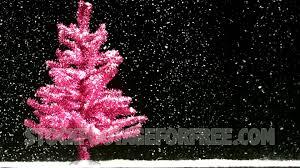 free pink christmas tree in snowfall winter seasonal stock video