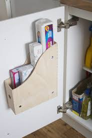 kitchen storage solutions using the inside of kitchen cupboard