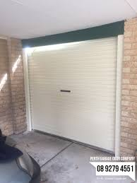 sectional doors perth perth garage doors today we installed a manual rollerdoor in classic cream with 2 jamb posts