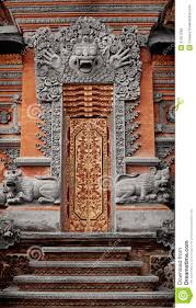 gate of temple decorated with ornaments indonesia bali stock