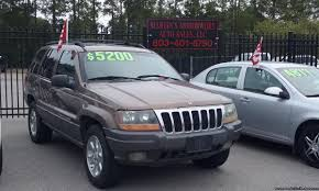 2000 gold jeep grand cherokee jeep grand cherokee laredo 4 7 for sale used cars on buysellsearch