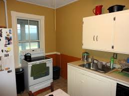kitchen kitchen colors with brown cabinets trash cans bakeware
