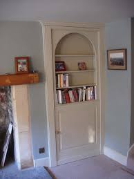 give surprise your guests with hidden door bookcase home design