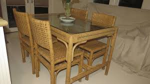 vintage mid century woven cane table and four chairs from