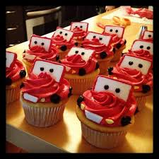 cars lightning mcqueen cupcakes in chocolate frosting these could be mater