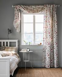 Purple Curtains Ikea Decor A Floral Printed Curtain Hangs In A Window In A Bedroom Ikea