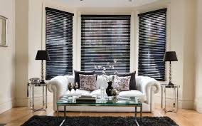modern living room using chesterfield sofa and black blinds