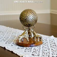brass elephants holding studded sphere ball made in india