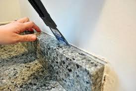 removing kitchen tile backsplash removing tile backsplash removing the side splash from our