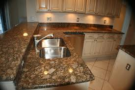 giallo fiorito granite with oak cabinets giallo fiorito granite kitchen traditional with brown light glaze
