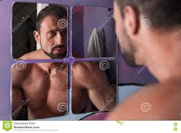 handsome shirtless muscle man wash face in the bathroom mirror