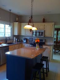 dual tone painted kitchen cabinets in off white distressed glaze