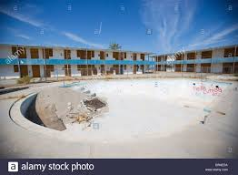 an empty swimming pool at an abandoned hotel and resort along the