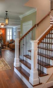 Wooden Stair Banisters And Railings Hardwood Flooring Up The Stairs U003d Classic Look Rod Iron Balusters