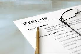 should objective be included in resume what you should and shouldn t put on your resume career center closeup of resume with pen and glasses on the table
