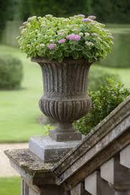 Pedestal Pots Stone Urn Planter On A Pedestal Planted With Sedum Via Gardening