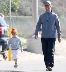 matthew mcconaughey leads the way as children join him for a jog