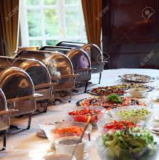array of dishes placed on buffet table stock photo picture and