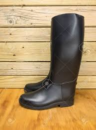 dirty riding boots dirty riding boots against a stable wall stock photo picture and