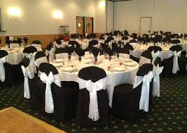 black and white chair covers white chair covers with clover satin sashes black table covers