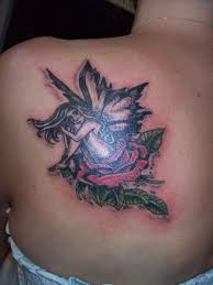 tattoo of a rose fairy sitting on a rose tattoo by drewcarcrazy on deviantart