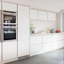 kitchen room white built in kitchen cupboards cabinet toe kick