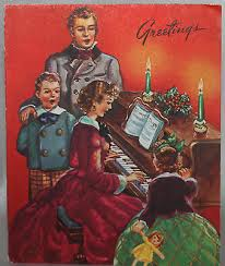 family singing christmas carols around the piano 1940 u0027s vintage