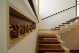 interior brown wooden stack loft stair connected by white wall in