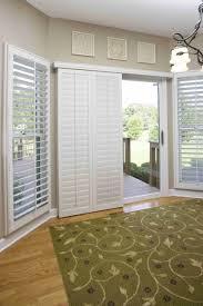 decorating sliding glass door and sunburst shutters in white on